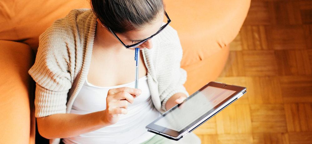 woman-reading-ipad_1940x900_33985.jpg