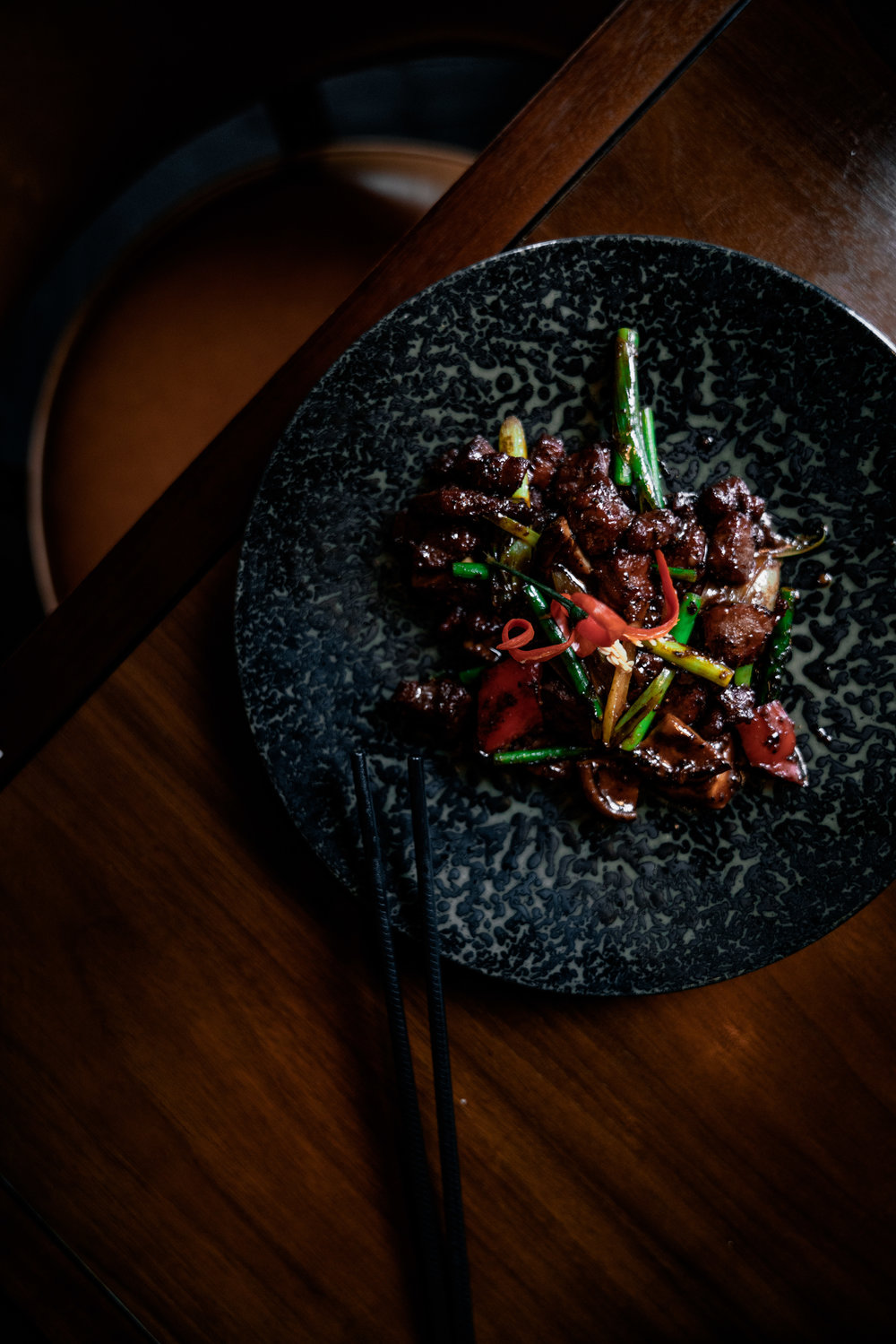 Wok fried Hereford beef fillet in spicy black pepper sauce