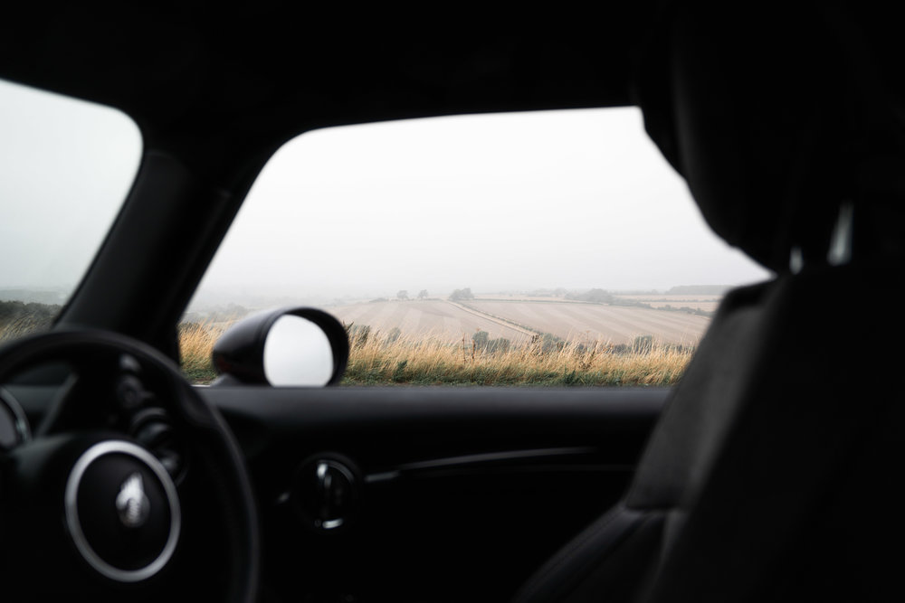 Inside a Mini Cooper, Foggy hills in the Cotswolds
