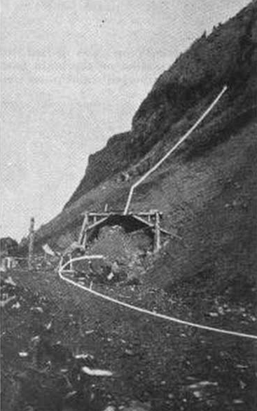 Photo of the south entrance of the Arch Cape tunnel from the July 1937 issue of Western Construction News
