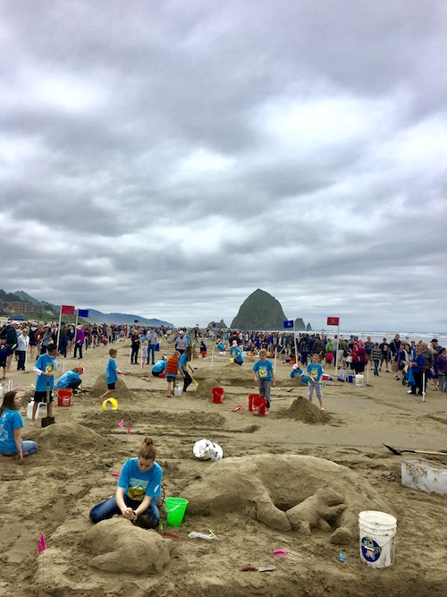 The Annual Cannon Beach Sandcastle Contest in the shadow of Haystack Rock