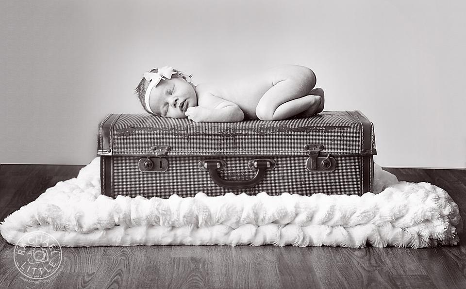 Newborn on suitcase