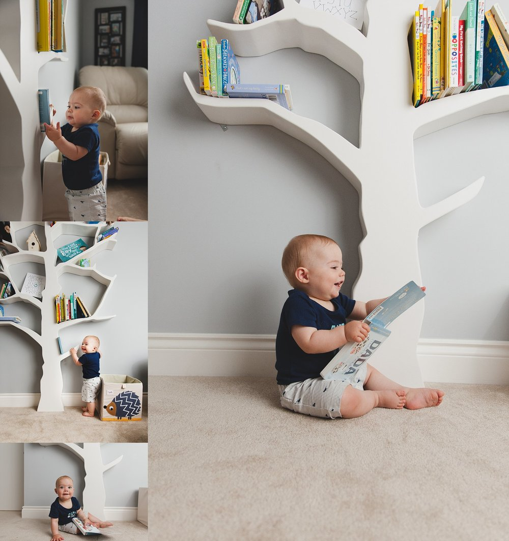 Baby Boy reading book next to tree bookshelf.Photographed near Woodstock, ON by Rachael Little Photography.