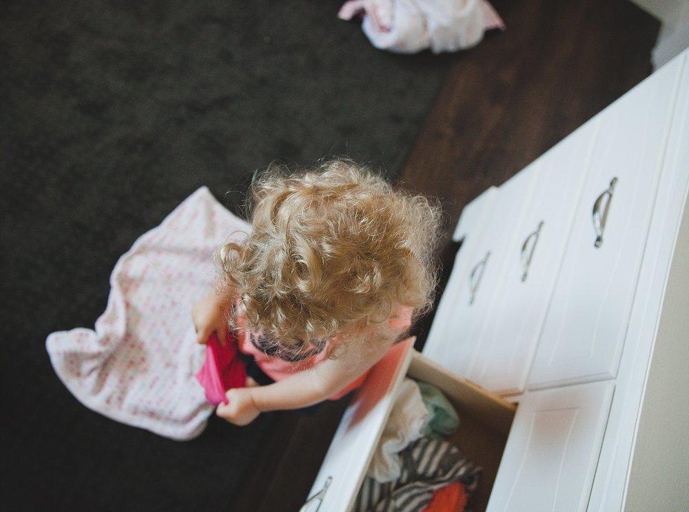 Toddler playing dressup.