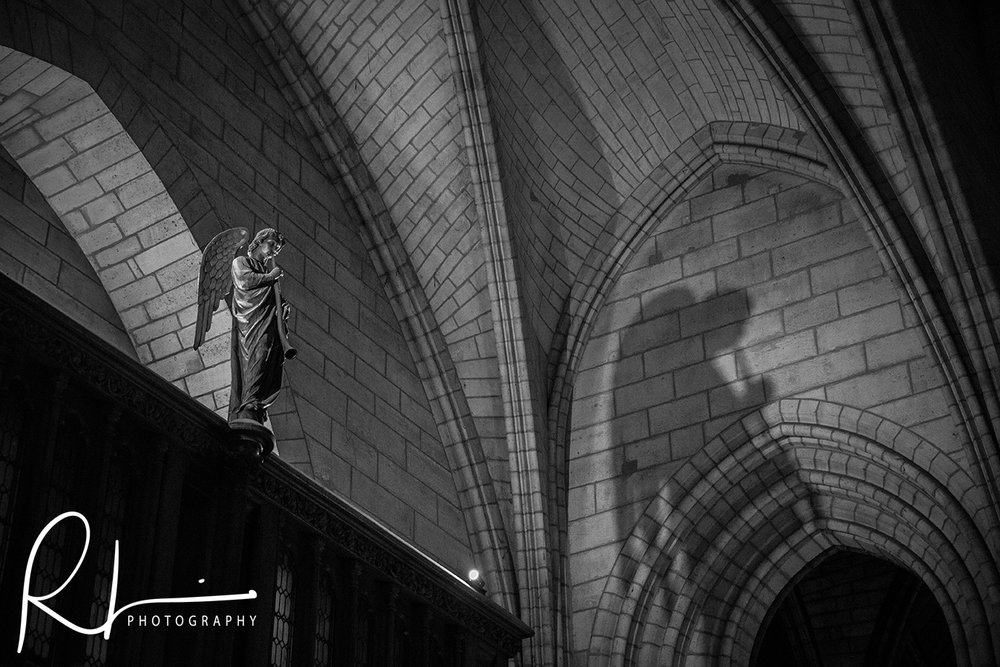 Angel statue shadow inside Notre Dame