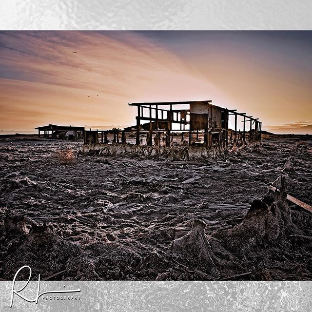 This is no longer standing. The image was taken a few years back in a small town called Bombay Beach right on the eastern shore of the Salton Sea. The elements and salt have eaten this structure up. #saltonsea #bombaybeach #bombaybeachruins #travelphotography #travelphotographer #desolatebeauty
