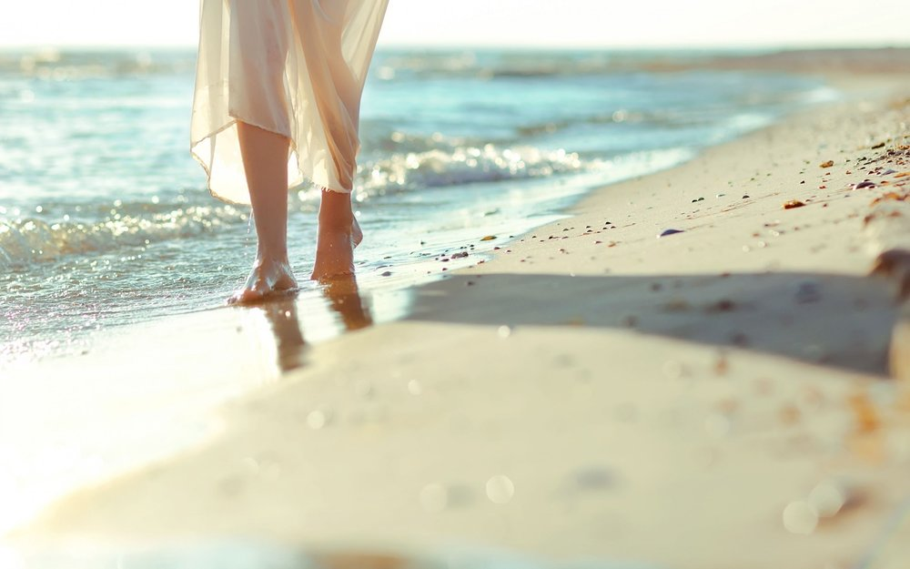 girl walking on beach.jpg