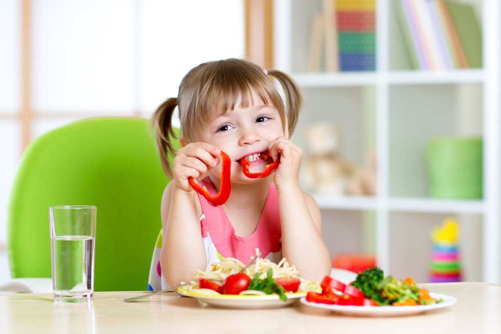 young girl eating veggies.jpg