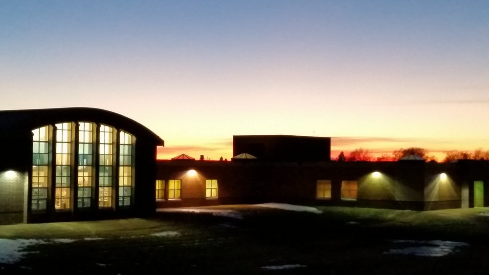 Back perspective of R.F. Pettigrew Elementary at dusk