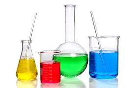 Image of chemistry beakers filled with different colored solutions (yellow, red, green and blue).