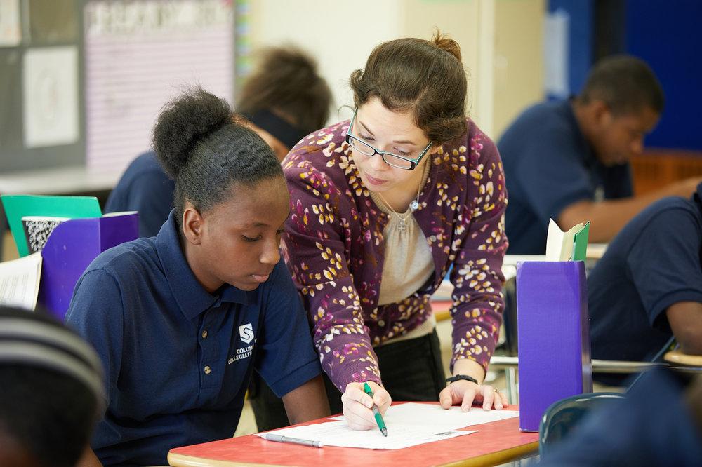 SPI-Photo-025_Teacher helping student_2014.jpg