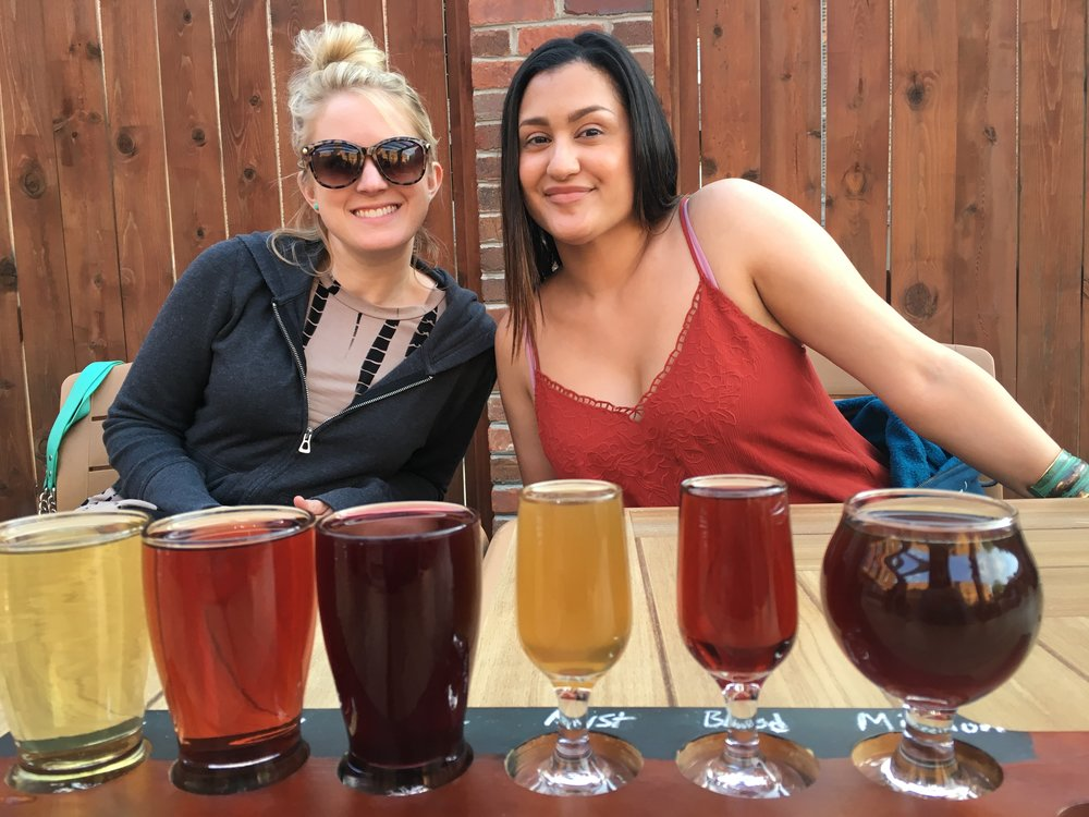 Deborah and Cynthia and our array of drinks at BottleHouse Brewery and Mead Hall.