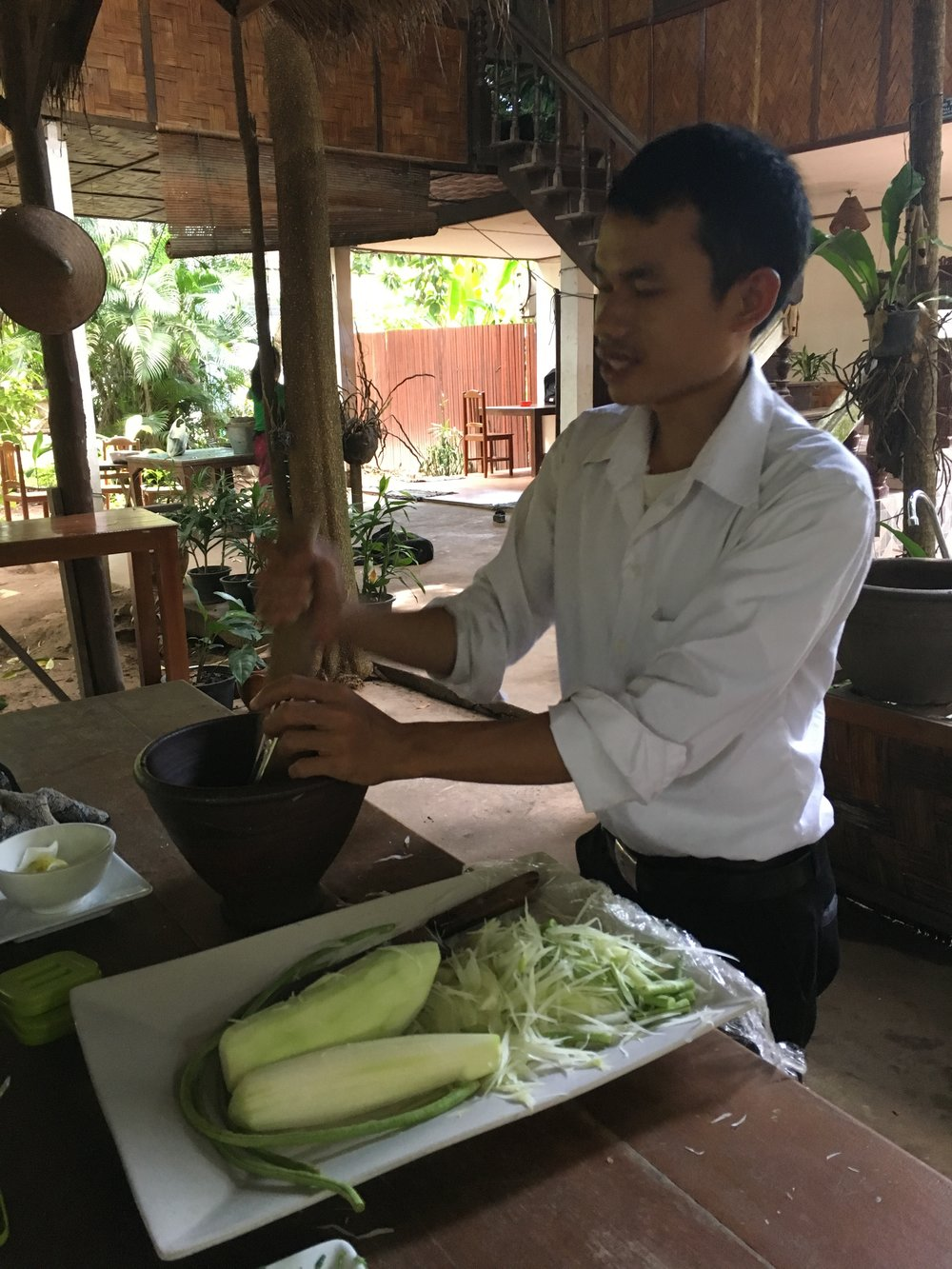 Young, green papayas for salad and the famed mortar and pestle.