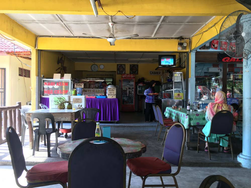 Warung Ambak has a covered al fresco dining area and a Malay food buffet.