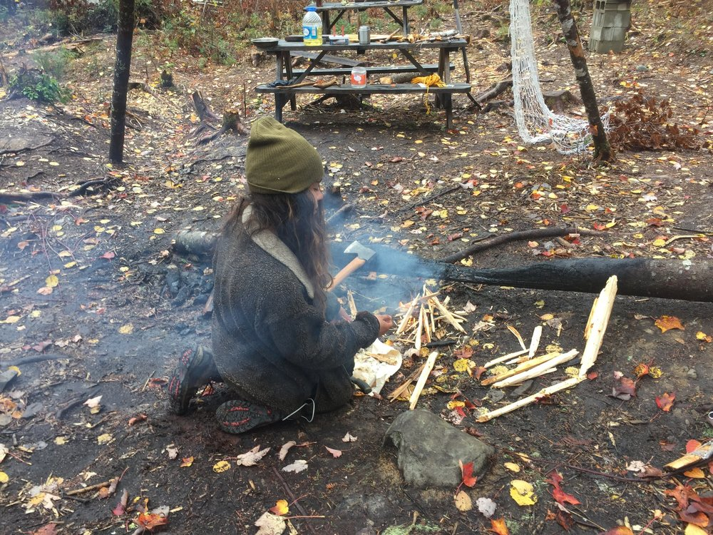 Allison uses her axe and knife to start a wet weather fire.