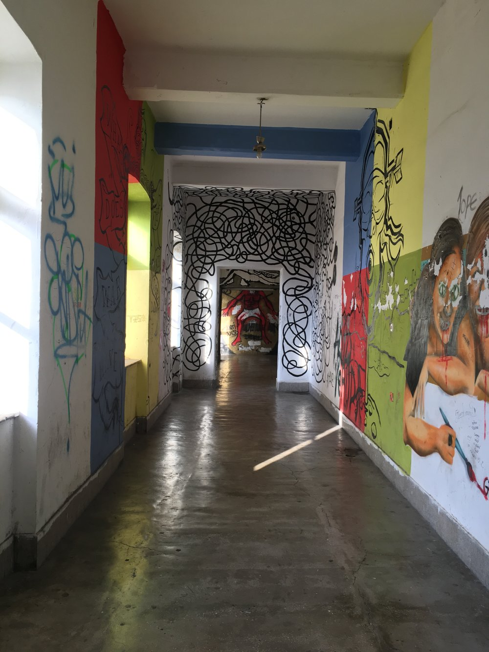 The cement floors and utilitarian white walls became canvasses for artists. Each turn brought something new.
