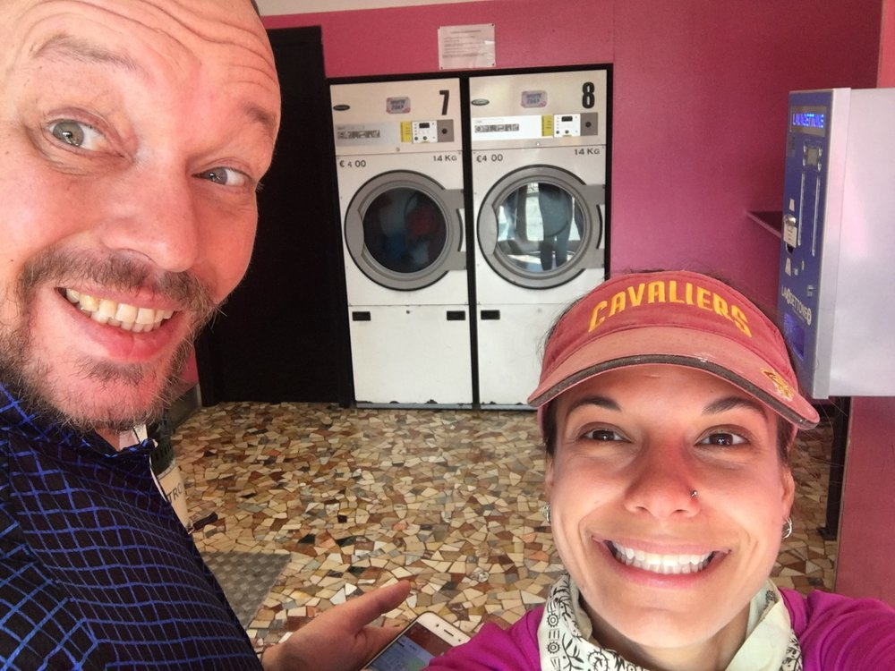 Can you tell Craig is thrilled to be at the pink laundry mat?