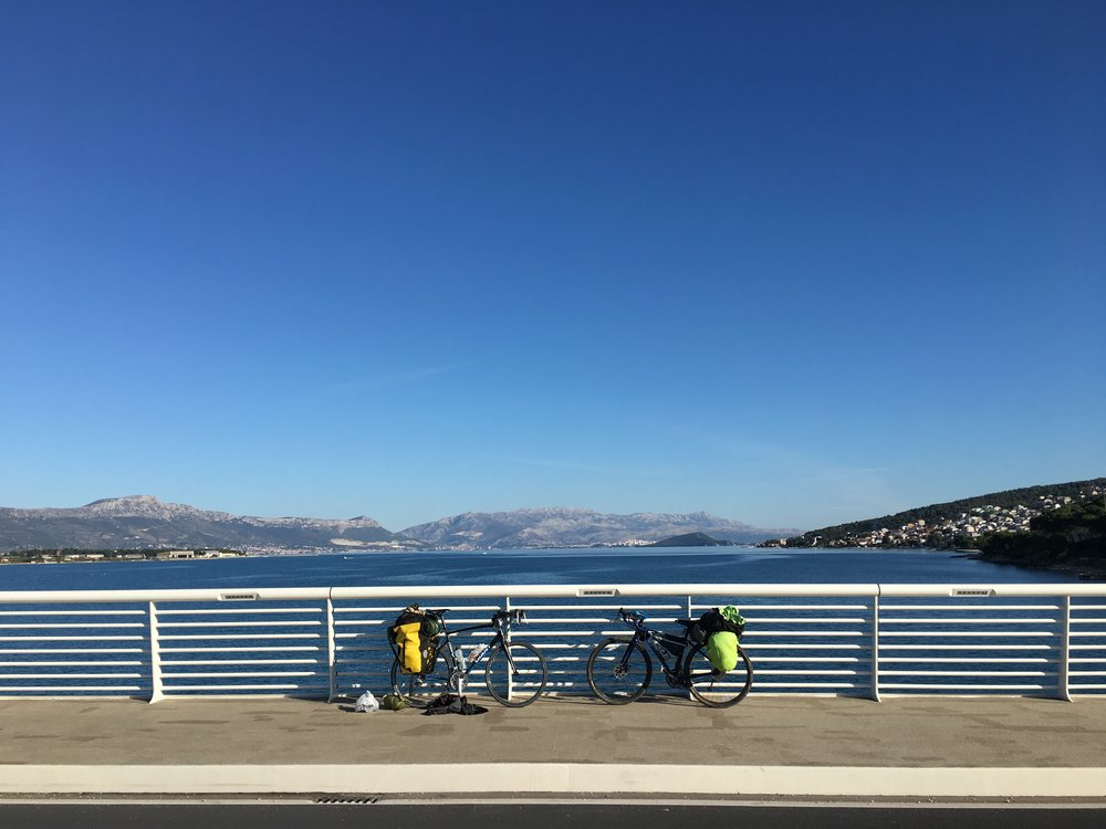 Our bikes on the Čiovo bridge with the Split peninsula in the background.