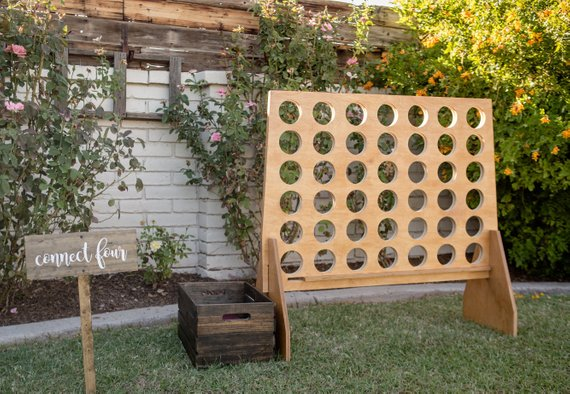 Yard Game Ideas to Keep Your Guests Smiling - Game by Rustic Road Designs Inc - #weddinggames #yardgames #weddings