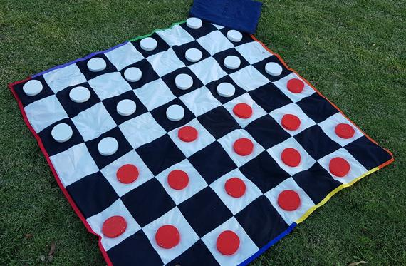 Yard Game Ideas to Keep Your Guests Smiling - Game by DSS Handmade - #weddinggames #yardgames #weddings