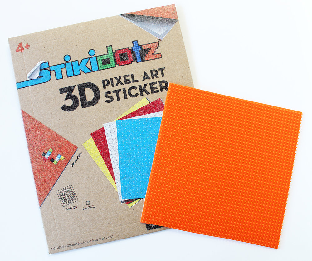 "Large STiKidotz Base   8 Color Choices Available  Create your own STiKidotz 3D Pixel Art Sticker.   Choose your color of 1 Large STiKidotz Base (42 x 42 Pixels / 7.25"" x 7.25""), dotzBLOKs sold separately.   MSRP $14.99     MORE INFORMATION     Available SOON!"