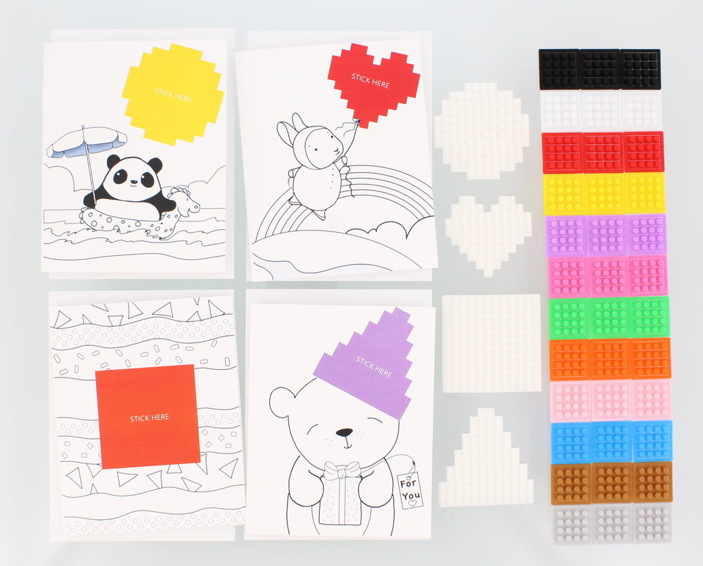 Each package comes with 4 greeting cards and envelopes, 4 stickers and 36 dotzBLOKs