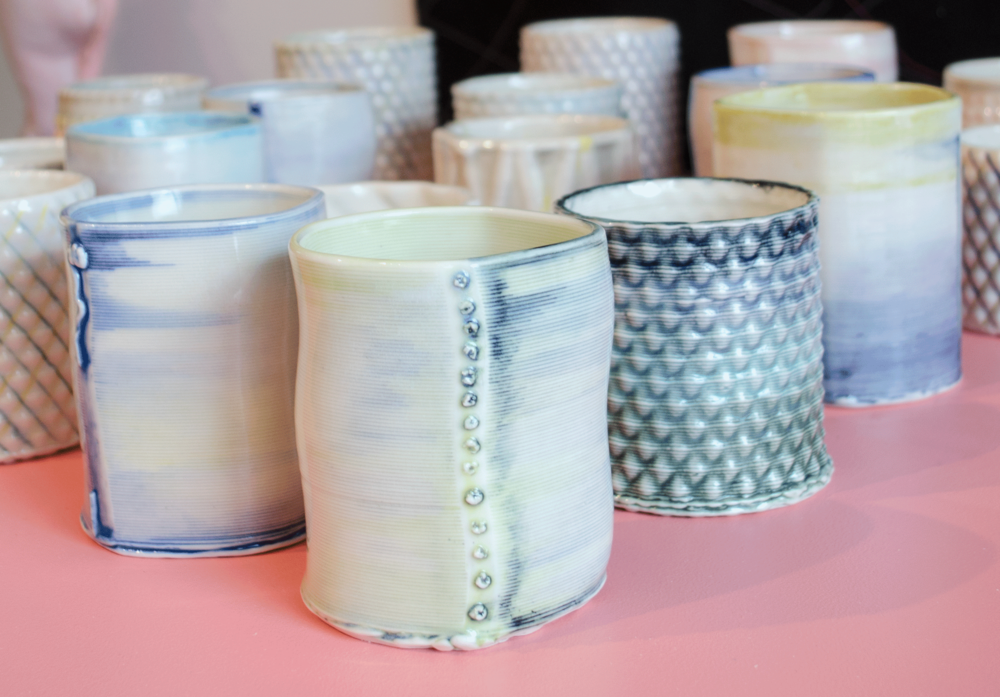 Designed to fit in the hand perfectly, this cup comes in two sizes: large and medium. We have played with colors and decorative accents. Design collaboration by Timea Tihanyi and Annabelle Wu.