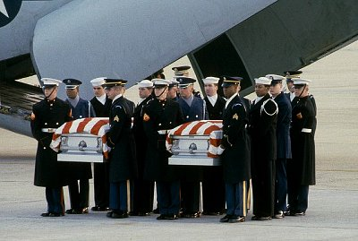 The bodies of Charles Hegna and William Stanford, who were killed by terrorists aboard an Iranian airliner, arrive home at Andrews Air Force Base in 1984. (Credit: Corbis)