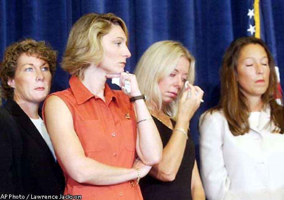 Family members of victims of the Sept. 11 terrorist attacks look on during a Washignton news conference Thursday, Aug. 15, 2002 where it was announced that legal action would be taken against Saudi officials and institutions, charging they financed Osama bin Laden's terrorist network. From left are, Ellen Saracini, whose husband Victor was the captain of United Airlines Flight 175; Tara Bane, whose husband died at the World Trade Center; Fiona Havlish, whose husband, Don, worked on the 101st floor of the south tower; and Sara Mulligan, wife of a New York firefighter. (AP Photo/Lawrence Jackson)