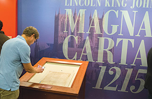 Visitors tour the Library of Congress new exhibit, Magna Carta: Muse and Mentor, in Washington, D.C.