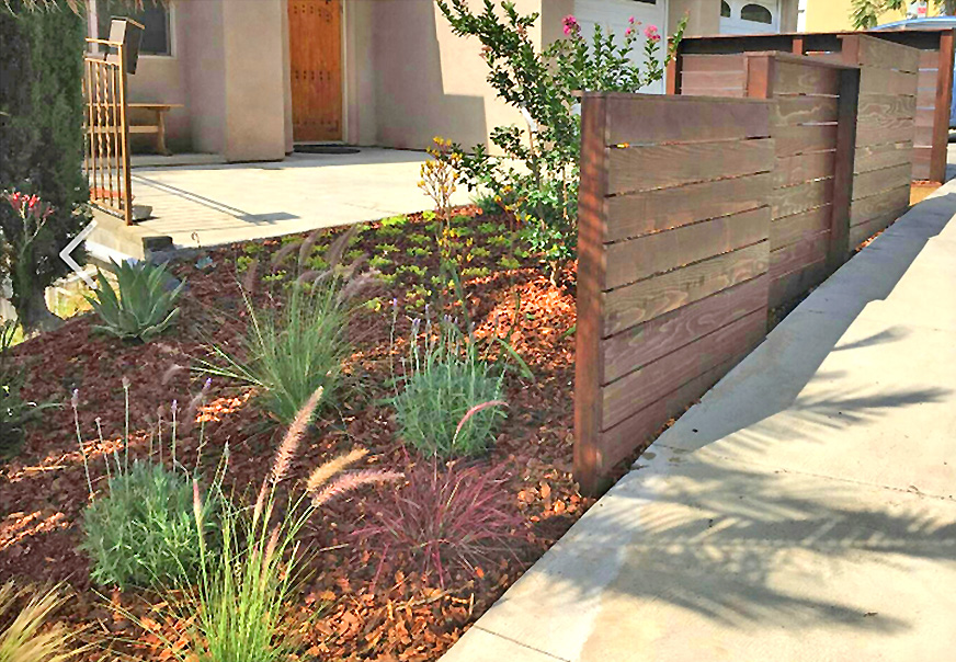 drought tolerant landscape_mulch_wood fence.jpg