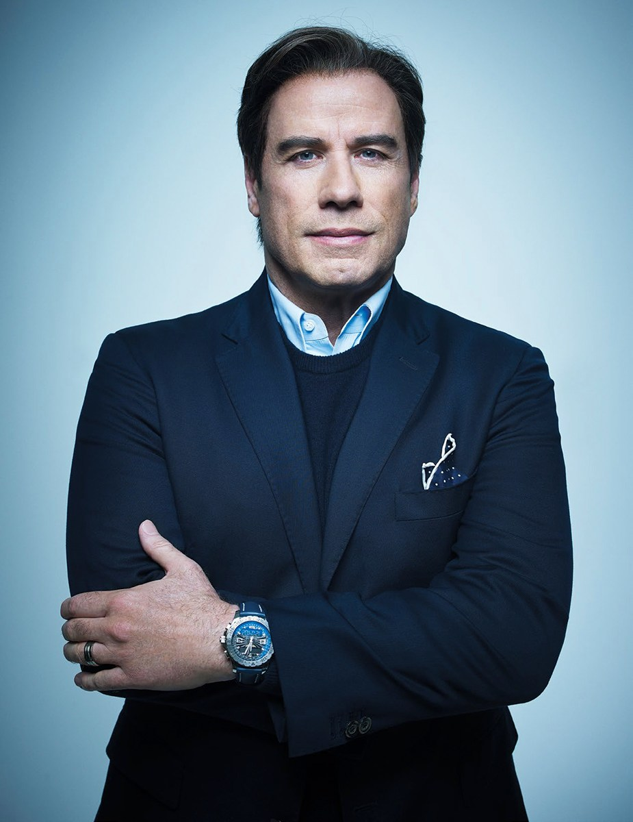 John Travolta as Robert Shapiro: Suit, shirt and pocket square by Matteo Perin; Sweater by Black Brown 1826; watch by Breitling. Photo: Robert Ascroft