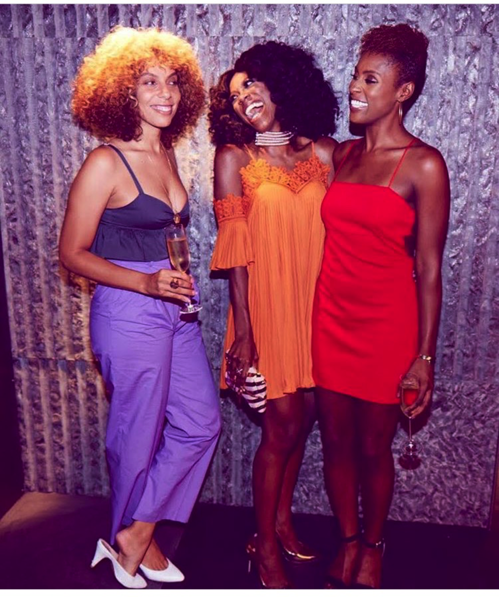 Melina Matsoukas (left), Yvonne Orji (middle), and Issa Rae (right), sport their hair in different natural styles at a dinner sponsored by Afropunk, RCA, Spotify, and Insecure. Photo taken from the instagram page of Issa Rae @issarae.