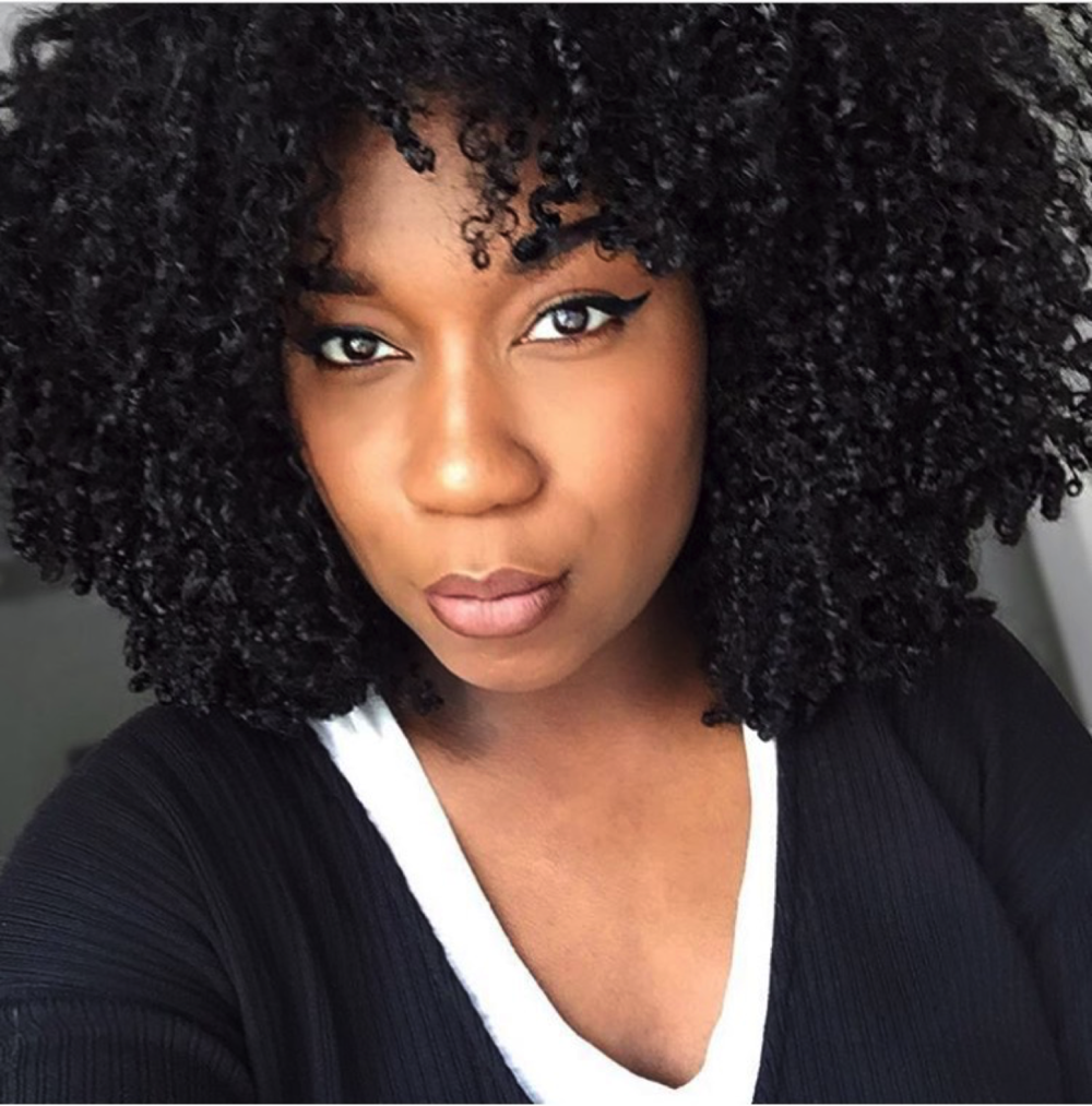 Whitney White, graphic designer, vlogger, and blogger showcases her natural curls after a Wash and Go. Photo taken from the instagram page of Whitney White @naptural85