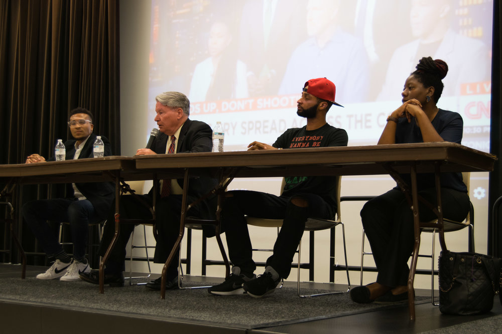 (from left to right: Aaron T. O'Neal, David Mitchell, Keith Wallace and Yejide Orunmila). David Mitchell, University of Maryland Police Chief, speaks during the Do Good Dialogue: Hands Up, Don't Shoot! hosted by The Clarice on Tuesday, Sept. 26, 2017. Chief Mitchell commented on the important role community policing can play in preventing tragedies like the shooting of Mike Brown.  Photo: Amina Lampkin