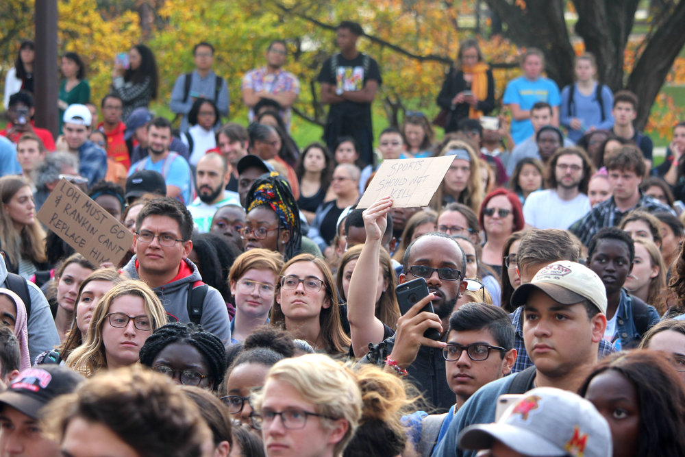 An assembly of students, alumni and outside allies congregate on the sidewalk and the neighboring street in front of the Main Administration Building at the University of Maryland, College Park., on Thursday, Nov. 1, 2018. (Alexandra Glover/The Black Explosion)