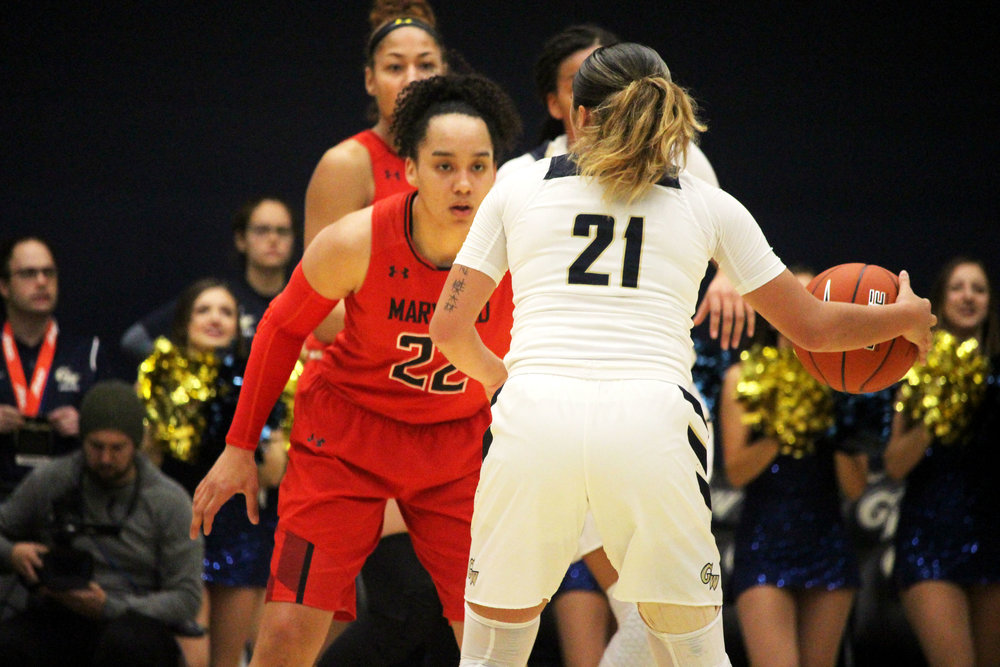 Maryland guard Blair Watson (22) buckles down on the defensive end, keeping George Washington guard Mei-Lyn Bautista (21) in front of her during the beginning of the first quarter at the Charles E. Smith Center in Washington on Wednesday, Nov. 14, 2018. The Terps won 69-30. (Alexandra Glover/The Black Explosion)