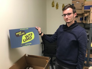 SGA President Jonathan Allen showcases sign for WTF campaign which is said to debut early next semester. (Jazmin Conner/The Black Explosion)