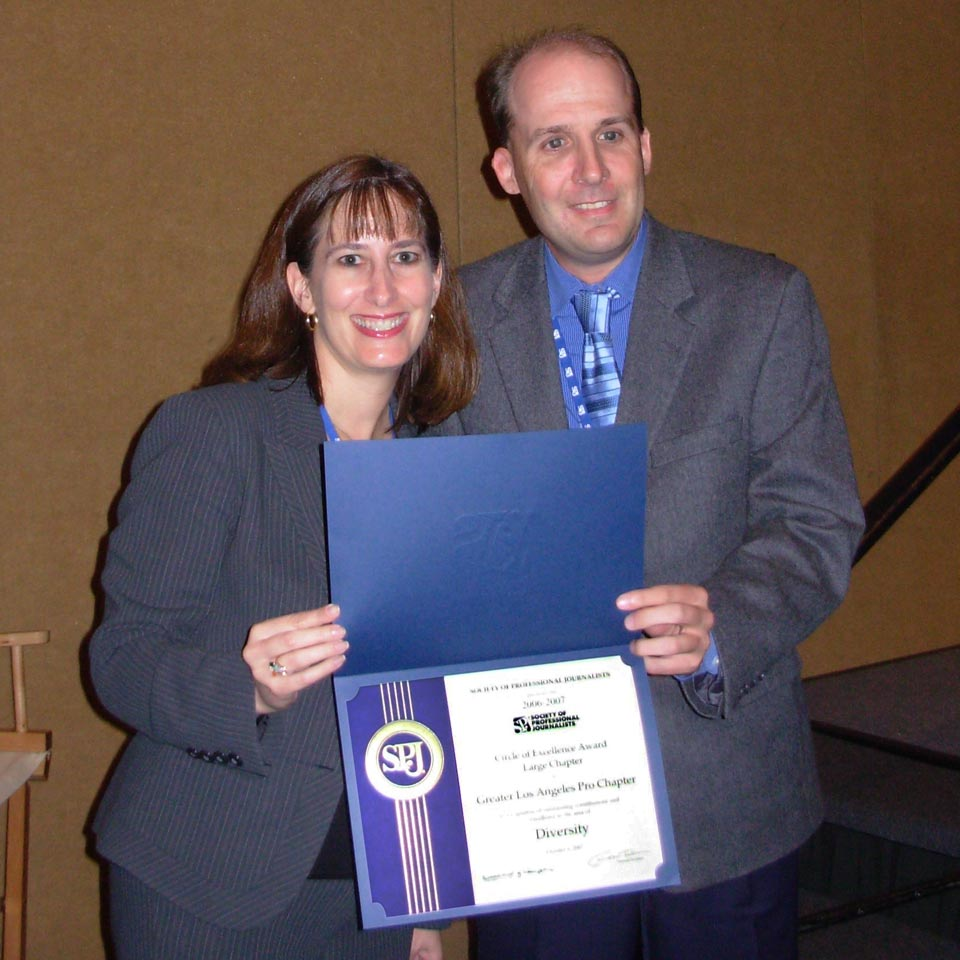 Lauren accepted an award from Dave at convention on behalf of SPJ/LA.