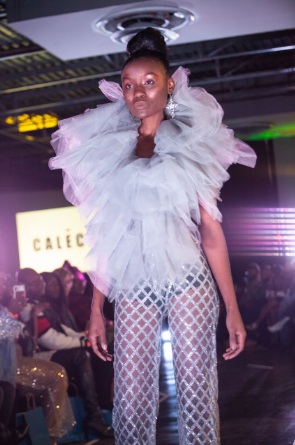 A model walks the runway wearing a look by Emerging Designer winner Kelechi Mitchell at Splashiversary during Magic City Fashion Week. (Reginald Allen, For The Birmingham Times)