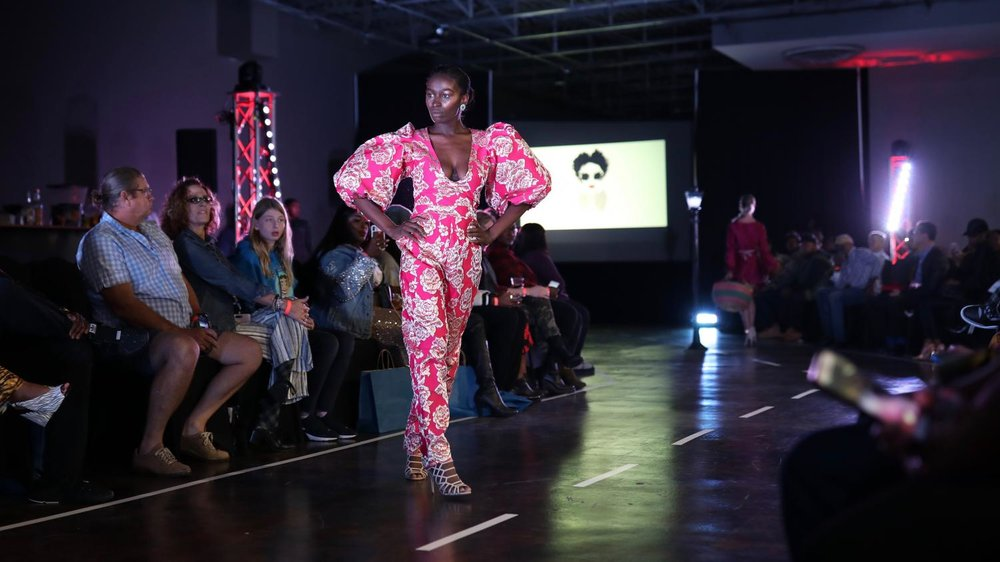 "A model walks the runway wearing Kenya Buchanan's ""Fruitopia"" line. CW/ Joe Will Field"