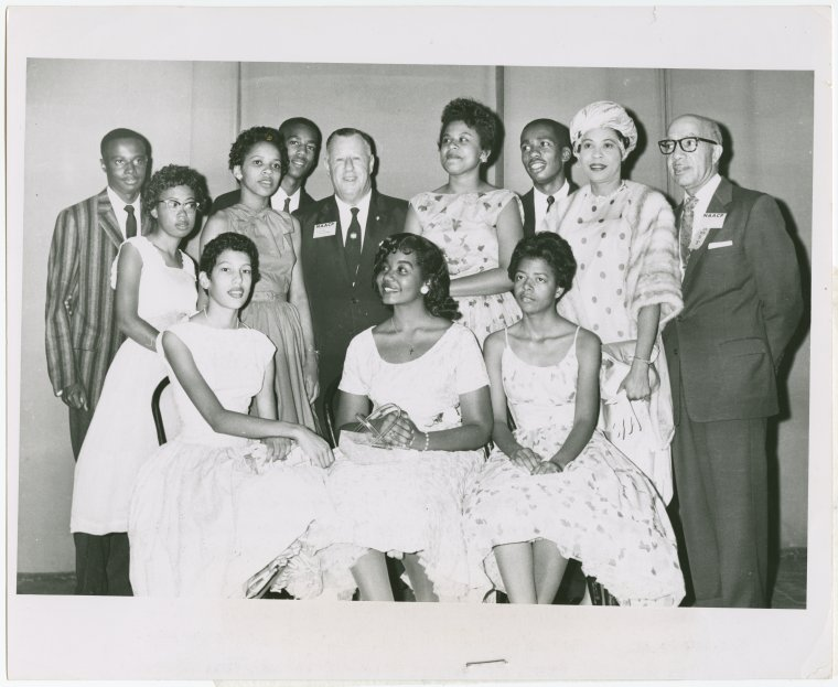 "Schomburg Center for Research in Black Culture, Photographs and Prints Division, The New York Public Library. ""Little Rock Nine and friends at NAACP's 49th annual convention in Cleveland, left to right, standing: Terrence Roberts, Thelma Mothershed, Gloria Ray, Jefferson Thomas, Kivie Kaplan, Minnijean Brown, Ernest Green, Mrs. L.C. Bates, Dr. James E. Levy; seated, Carlotta Walls, Melba Patillo and Elizabeth Eckford."" The New York Public Library Digital Collections. 1958. http://digitalcollections.nypl.org/items/8e0ab460-3606-4be6-e040-e00a18063fa6   The photo above is the Little Rock Nine and others at the 49th NAACP convention held in Cleveland, Ohio. The Little Rock Nine were the first Black students to integrate an all-white school."