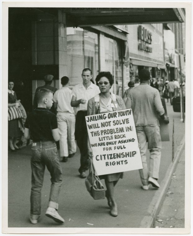 "Schomburg Center for Research in Black Culture, Photographs and Prints Division, The New York Public Library. ""Daisy Bates takes a walk - Activist Daisy Bates picketing with placard"" The New York Public Library Digital Collections. 1957.  http://digitalcollections.nypl.org/items/8e0aac3d-a58d-b26d-e040-e00a1806380e    Daisy Bates was an activist and journalist, above she is pictured holding a sign protesting the Little Rock Integration crisis of 1957.  She was known of her work against it."