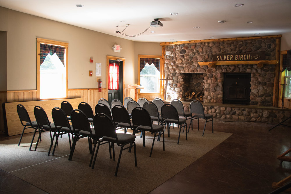 The Fireside Room - The Fireside Room is located in the lower level of the Canteen. During the summer months it is used as a meeting room, and as a meeting room for camper seminars.