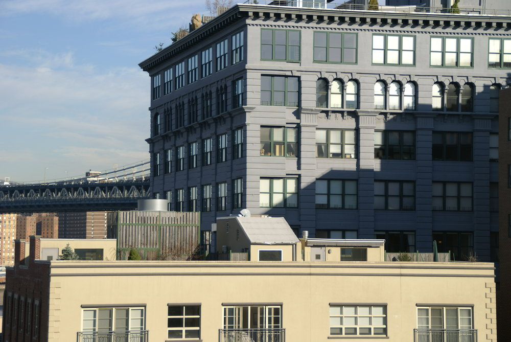 I love this photo because, if you zoom in on the top left corner window of the grey building, you can see the lovely spiral staircase leading up to the rooftop terrace. Talk about #homeownergoals, sheesh!