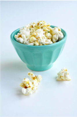 superfood popcorn with bee pollen in teal bowl