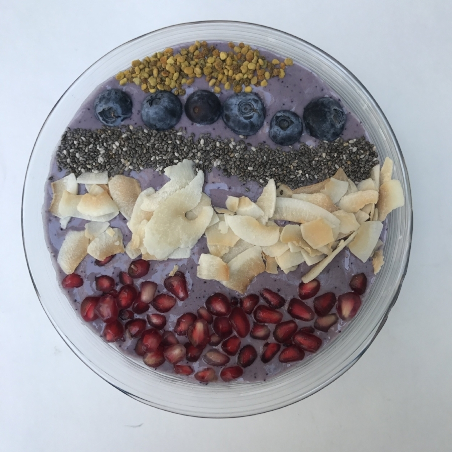 fruit breakfast beauty bowl with blueberries coconut and pomegranate seeds