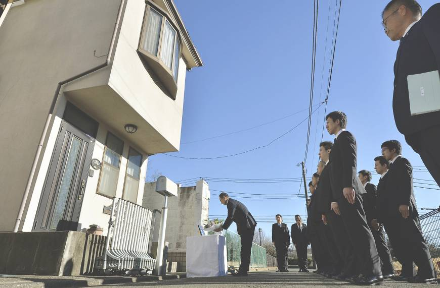 Police paying their respects to the Miyazawa family at their home, years later