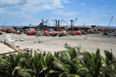 Somalia's seaport bustles with business as trucks come to offload ships of their cargo. Credit: UN Photo/T. Jones.