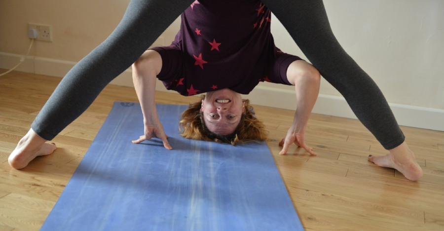 Prasarita Padottanasana - Step your legs wide apart, knees bent, fold forwards at your hips using your hands as brakes to walk down your legs, hold and breath at an appropriate place for your body. Straighten your legs and rest your hands on the floor or a block if you want to go further.